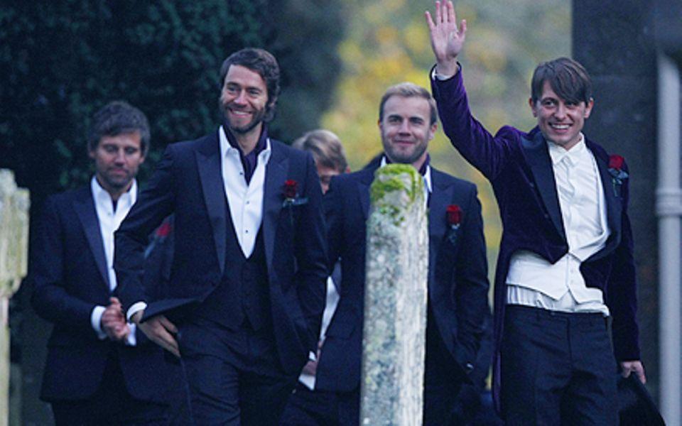 In Festlicher Stimmung: Mark Owen (r.) und seine Bandkollegen Jason Orange, Gary Barlow, Howard Donald (v.l.n.r.)