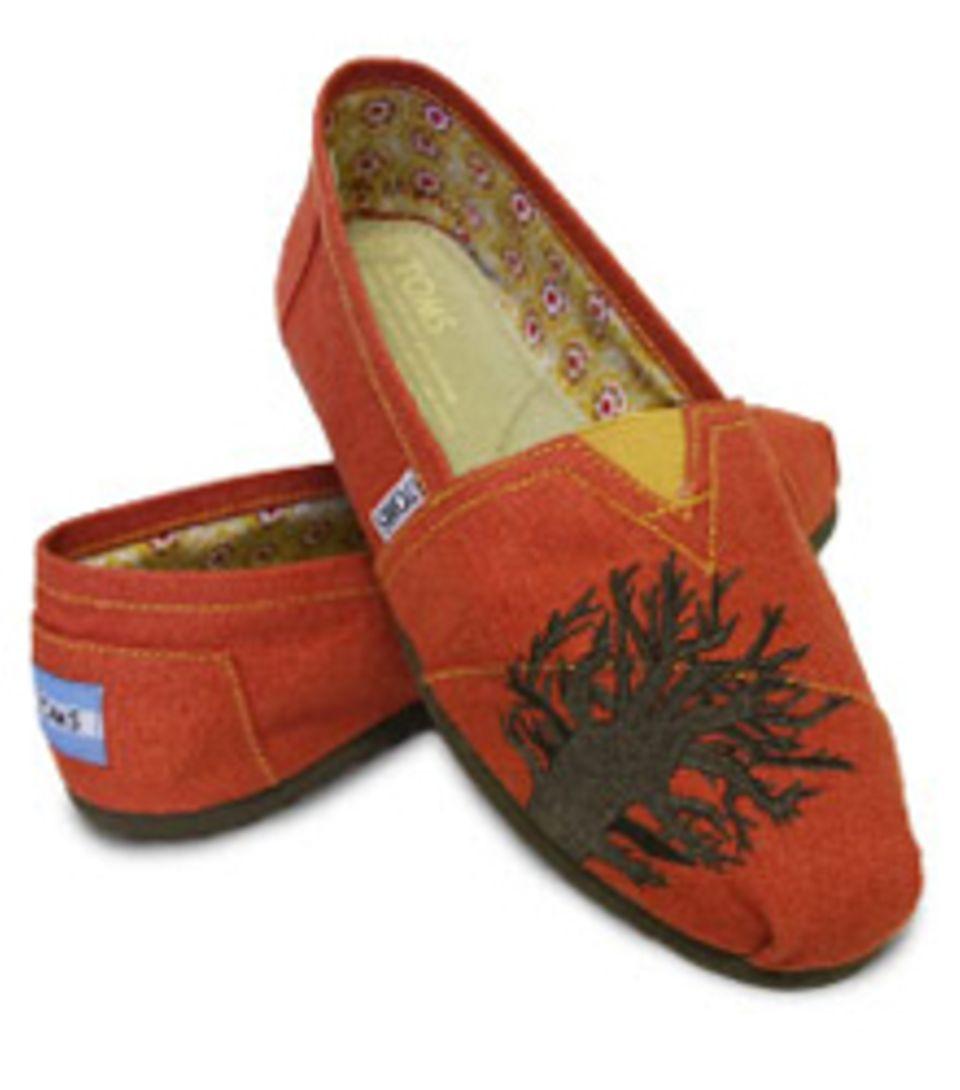 Der afrikanische Baobab Maum schmückt die Charity-Schuhe von Charlize Theron.