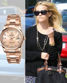 Reese Witherspoon trägt eine Oyster Perpetual Day-Date in Gelbgold