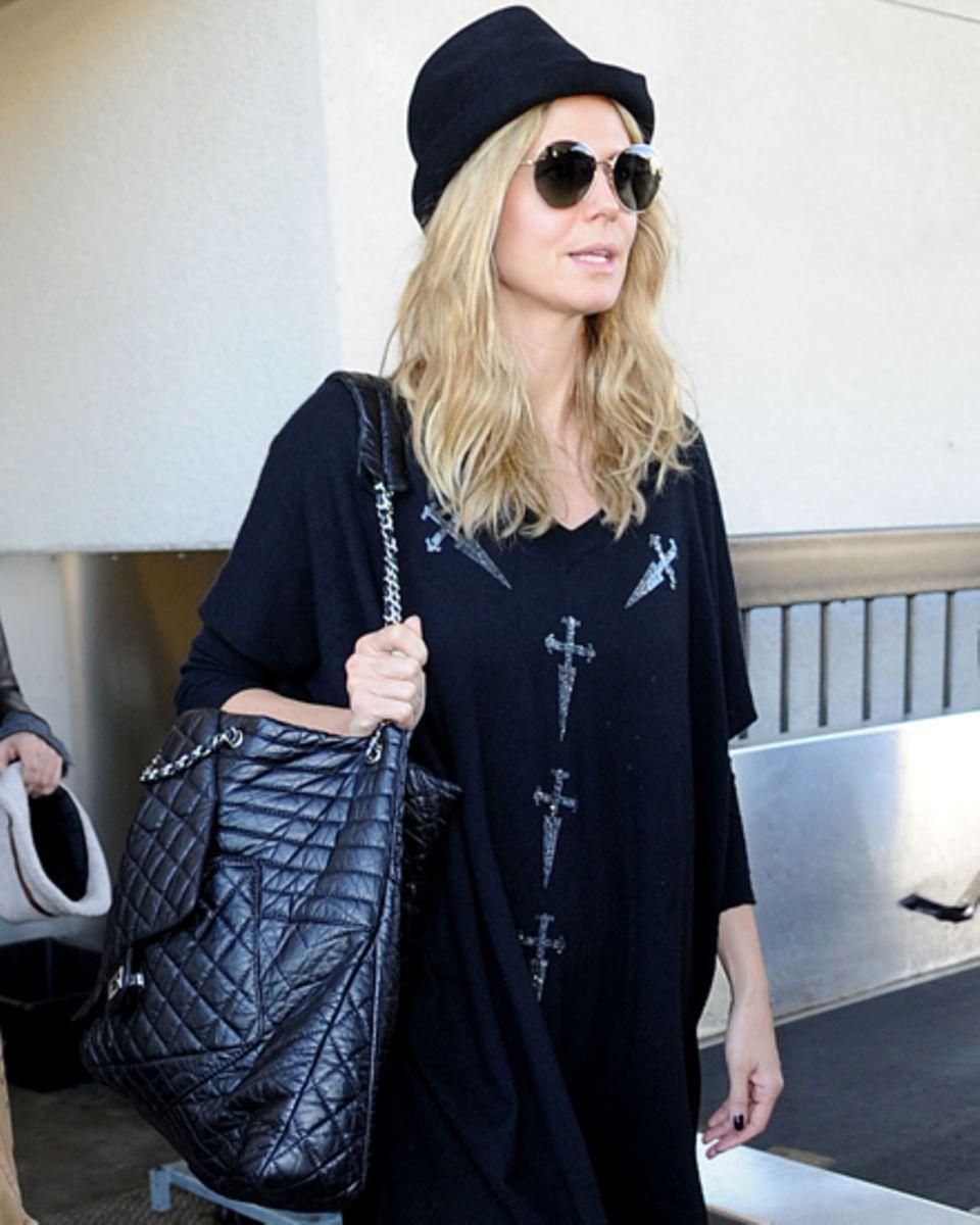 Sonnenbrille auf - und durch! Äußerlich lässt sich Heidi (hier am Flughafen in Los Angeles) nicht anmerken, wie es in ihr aussie