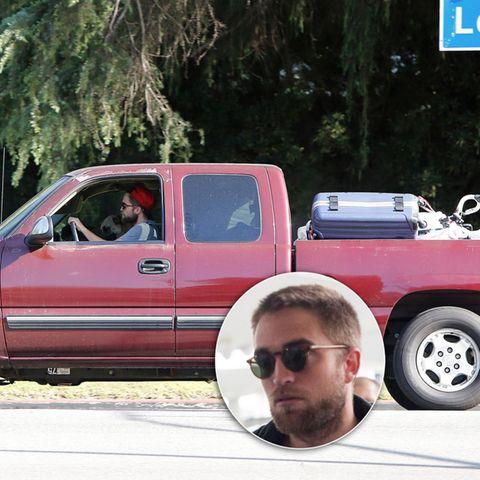 Robert Pattinson hat seinen Pickup-Truck mit seinen Habseligkeiten vollgeladen und fährt zu seinem Haus in Los Feliz.