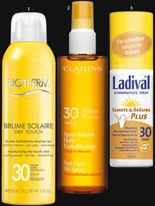 """1. Das """"Brume Solaire Dry Touch SPF 30"""" von Biotherm mattiert. 200 ml, ca. 26 Euro; 2. Die """"Dry Oil""""-Textur des """"Spray Solaire Huile Embellissante SPF 30"""" von Clarins ist auch fürs Haar geeignet. 150 ml, ca. 29 Euro; 3. Erhöht die natürliche Melaninbildung: """"Schutz und Bräune Plus Spray SPF 30"""" von Ladival, 150 ml, ca. 19 Euro."""
