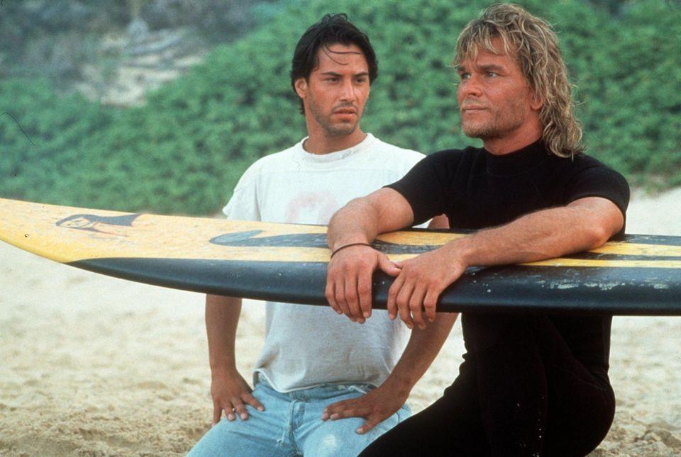 """Mit """"Gefährliche Brandung"""" landeten Keanu Reeves (l.) und Patrick Swayze 1991 einen Kassenschlager. Im Juli startet der Dreh des Remakes."""