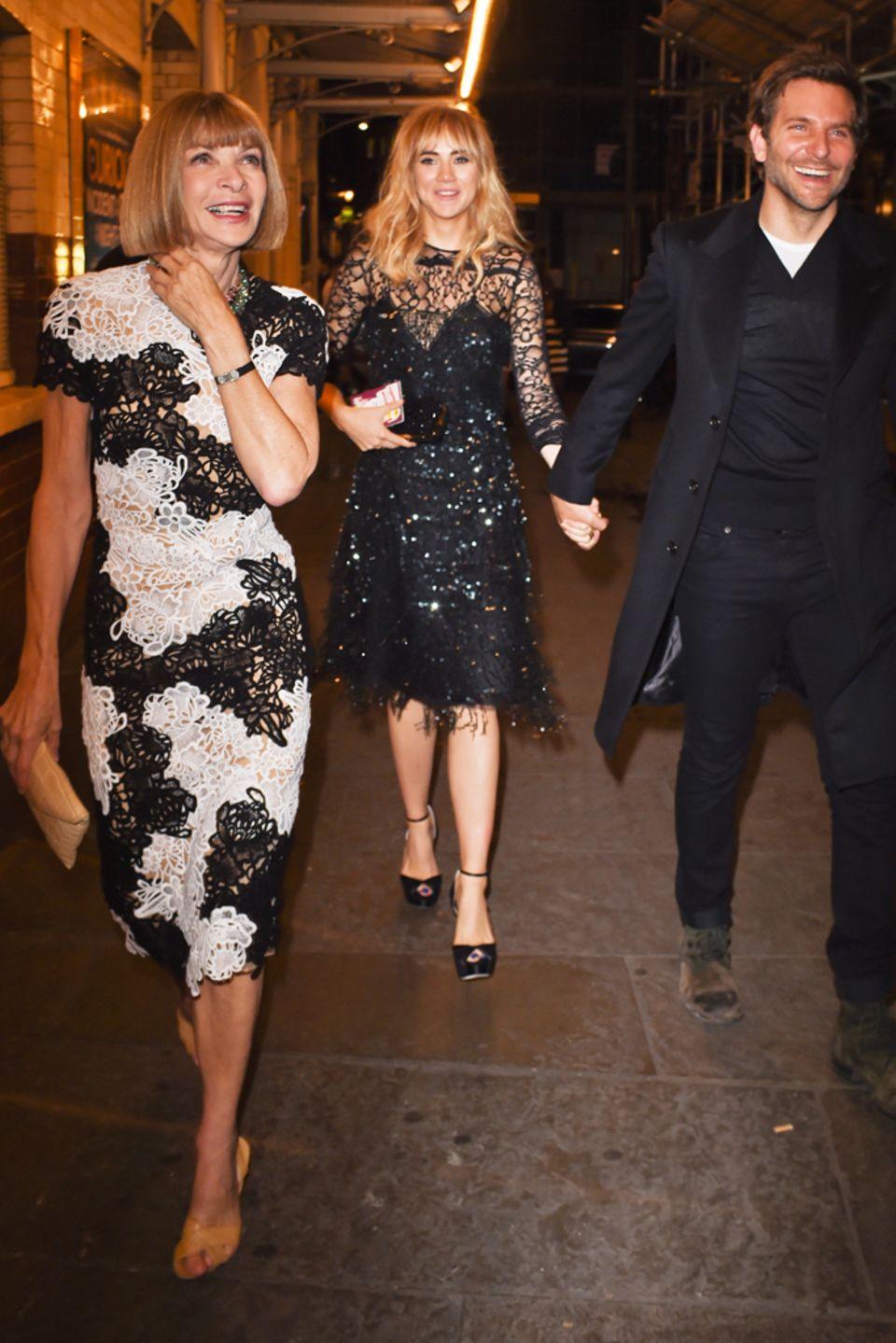 Anna Wintour, Suki Waterhouse und Bradley Cooper während der Fashion Week in London.