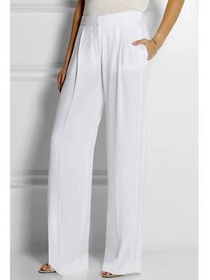 Diese Hose von Stella McCartney trug Amal Alamuddin als sie George Clooney das Jawort im Standesamt in Venedig gab.