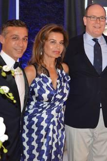 Fürst Albert von Monaco mit Mitra Moghadam (mitte) und ihrem Sohn Kamyar (l.)