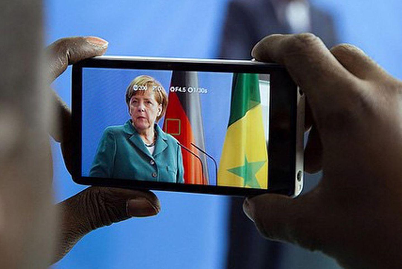 Angela Merkel lässt fotografieren.
