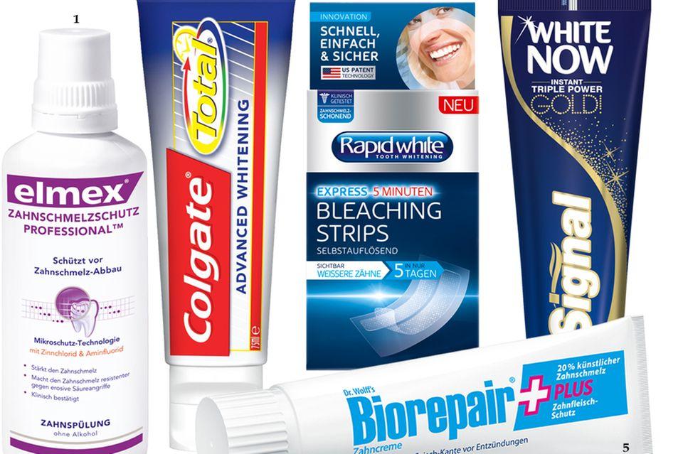 """1. Wirkt gegen Säuren aus Zitrusfrüchten: """"Zahnschmelzschutz Professional Zahnspülung"""" von Elmex, 400 ml, ca. 6 Euro; 2. Hellt etwas auf, beruhigt das Zahnfleisch und wirkt antibakteriell: """"Colgate Total Advanced Whitening"""", 75 ml, ca. 2 Euro; 3. Ideal, um z. B. einzelne Zähne ganz einfach aufzuhellen: """"Bleaching Strips"""" von Rapid White, 28 Streifen mit Aufhellpaste, ca. 16 Euro; 4. Trickst durch blaue Pigmente weißere Zähne: Zahnpasta """"White Now Gold"""" von Signal, 75 ml, ca. 3 Euro; 5. Macht den Zahn robuster und schützt mit Hyaluronsäure vor Entzündungen: """"Biorepair Plus Zahncreme"""" von Dr. Wolff, 75 ml, ca. 5 Euro"""