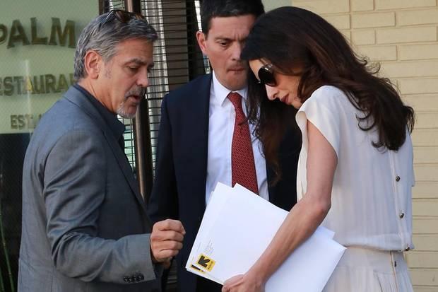George Clooney, David Miliband, Amal Clooney