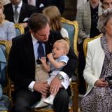 Chris O'Neill mit seinem Sohn Nicolas auf dem Schoß.