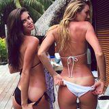 """Das passiert, wenn die """"Victoria's Secret"""" Engel Sara Sampaio und Candice Swanepoel vergessen, sich beim Foto-Shooting auf Bora Bora einzucremen. Autsch!"""