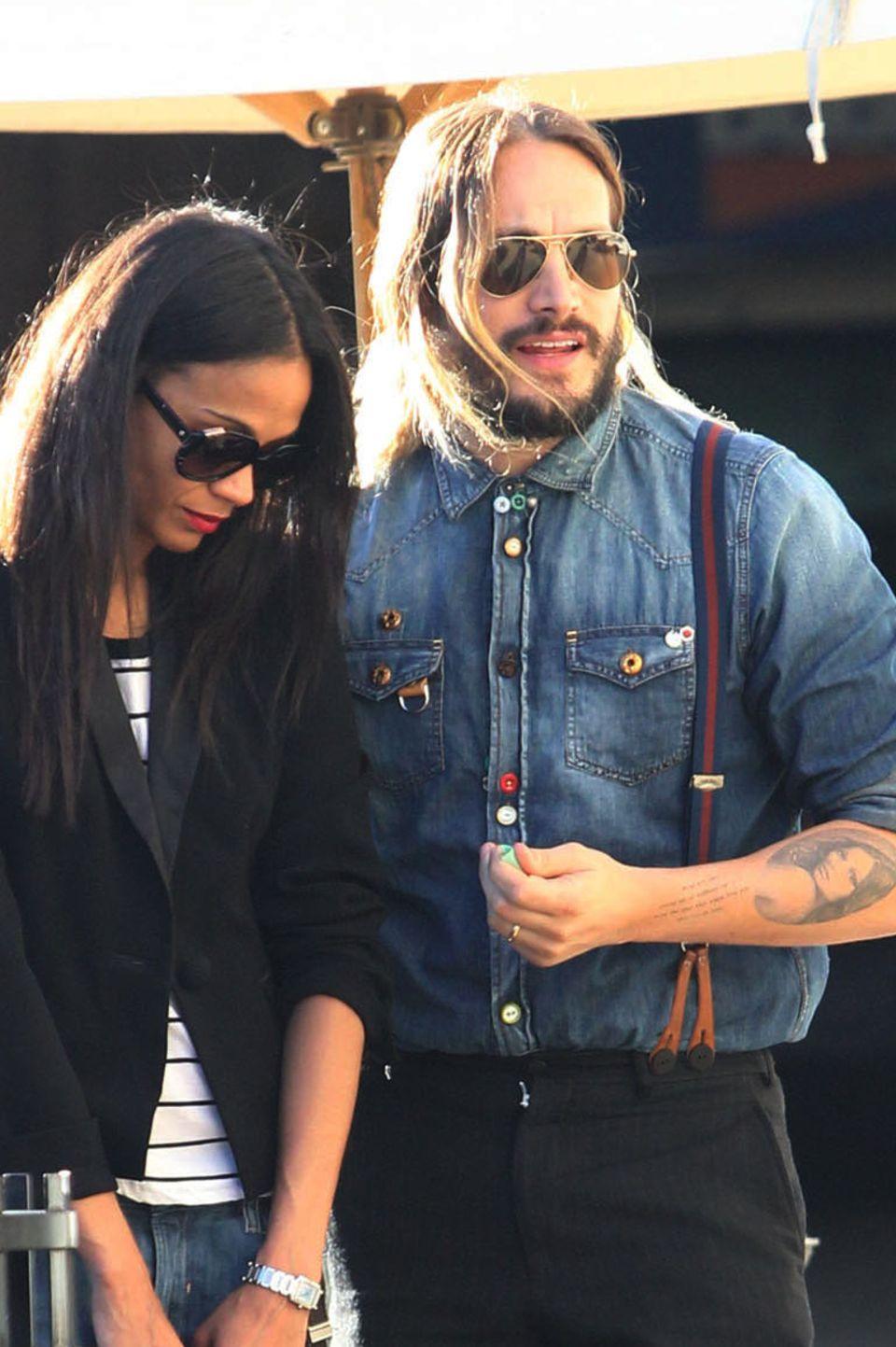 Zoe Saldanas Mann Marco Perego hat sich das Gesicht seiner Frau auf seinem linken Unterarm verewigen lassen.