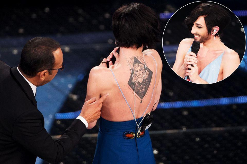 """Beim """"Sanremo""""-Festival lüftet Conchita Wurst das Geheimnis ihres riesigen Tattoos auf ihrem Rücken. """"Das ist meine Mutter, sie heißt Helga"""", verrät sie."""