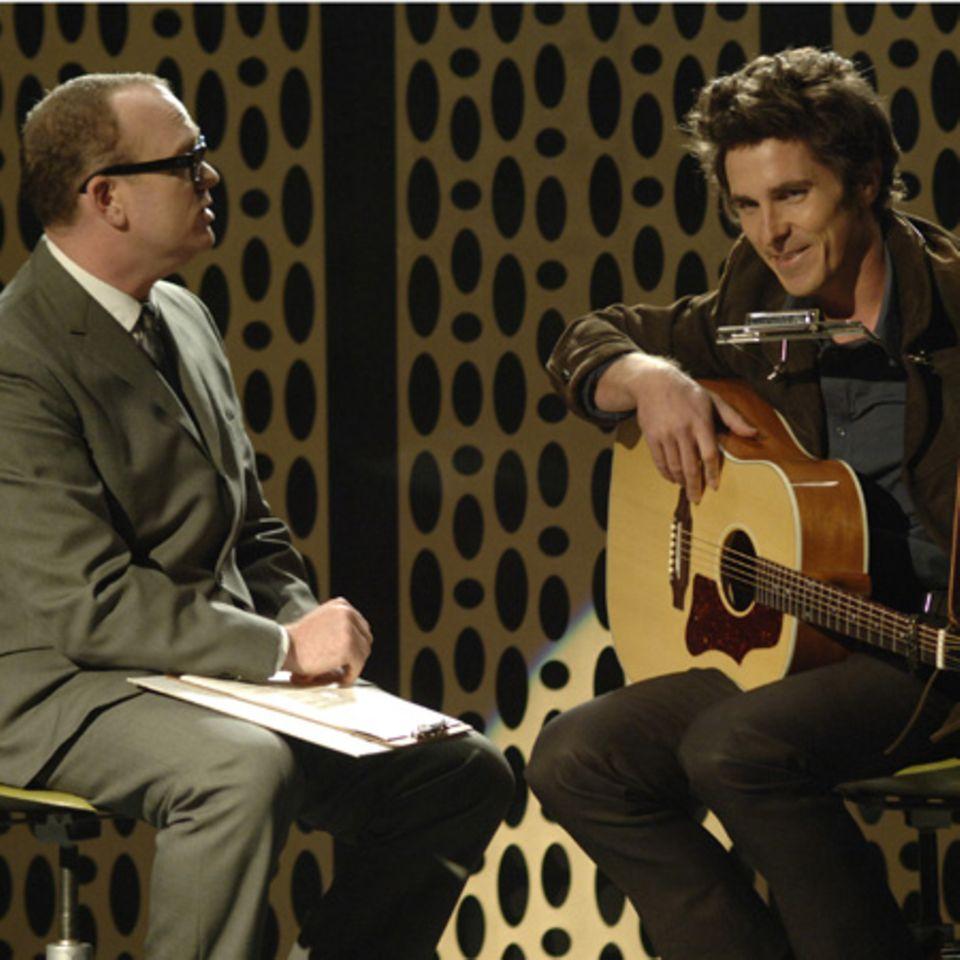 Christian Bale als Folksänger Jack Rollins