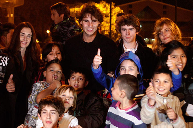 14. Dezember 2011: Die spanische Schauspielerin Paz Vega, Tennisprofi Rafael Nadal, der britische Schauspieler Freddie Highmore