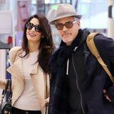George Clooney und seine Frau Amal sind Thanksgiving auf dem Weg zu ihrem Flugzeug am Londoner Flughafen.