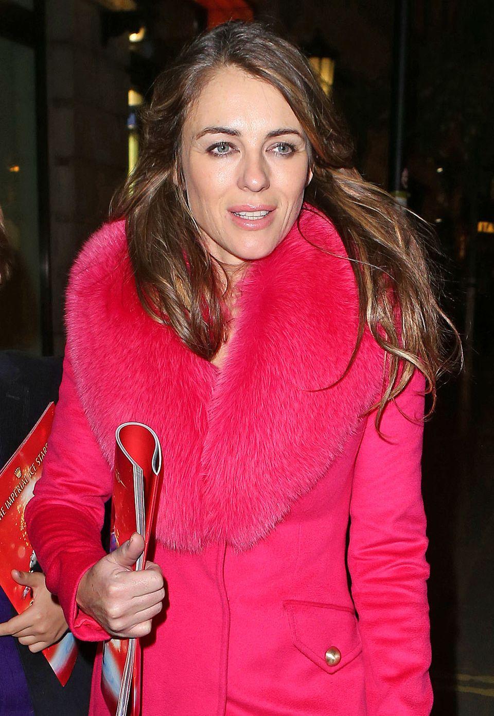 Pink ist einfach Liz Hurleys Farbe, da wird auch beim Mantel mit Pelzkragen keine Ausnahme gemacht.