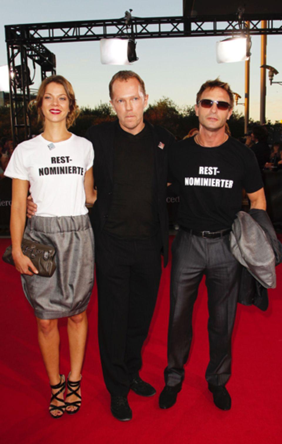 Stummer Protest: Mit T-Shirts machen Jessica Schwarz und Thomas Kretschmann auf sich aufmerksam.