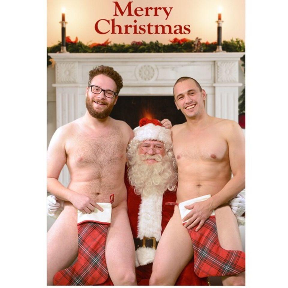 Für einen ganz besonderen Gruß posieren Seth Rogen und James Franco nackt auf Santas Schoß.