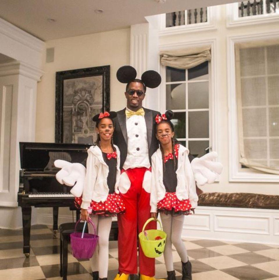 """Das muss Rapper P. Diddy wohl gerade denken: Wenn deine Töchter als """"Minnie Mouse"""" gehen möchten und dich dabei als """"Mickey Mouse"""" haben wollen, dann verkleidest du dich eben als """"Mickey Mouse"""", egal ob du nun ein cooler Rapper bist oder nicht."""