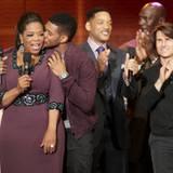 Ein letztes Küsschen für Oprah: Usher & Co verabschieden die Mutter aller Talkshow-Gastgeberinnen.