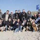 Gruppenfoto in Champagnerlaune