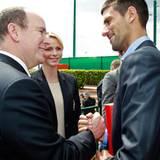 """16. April 2012: Fürst Albert und Fürstin Charlène treffen Tennisprofi Novak Djokovic bei den """"Monte Carlo Masters"""" in Monaco."""
