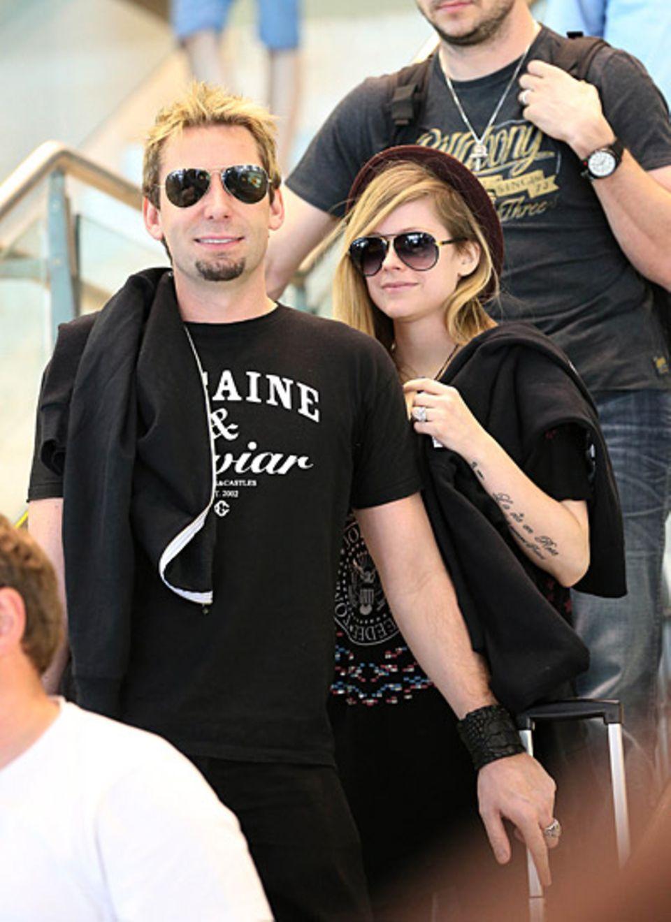 22. November 2012: Chad Kroeger und Avril Lavigne kommen gut gelaunt in Sydney an.