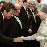 1998: Königin Elisabeth II. und Dennis Quaid