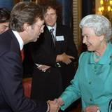 2005: Königin Elisabeth II. und Eric Clapton, Brian May