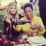 So macht Arbeiten Spaß: US-Talkerin Oprah Winfrey besucht Sängerin Fergie auf deren Weingut.