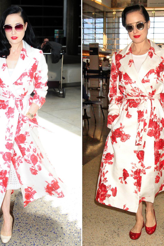 Dita von Teese hat mit ihrem rot-weißen Mantel mit floralem Print den optimalen Reisebegleiter gefunden. Deshalb darf das gute Stück auch immer wieder mit.