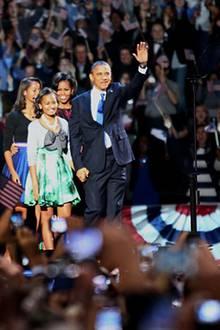 Barack Obama hat die Präsidentschaftswahl gegen Herausforderer Mitt Romney für sich entscheiden können und feiert mit seiner Fam