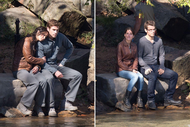 """1. Oktober 2013: Jennifer Lawrence und Liam Hemsworth drehen im Wald von Georgia eine Szene für """"The Hunger Gmaes"""". Bis der Dreh allerdings losgehen kann, halten ihre Double die Stellung."""
