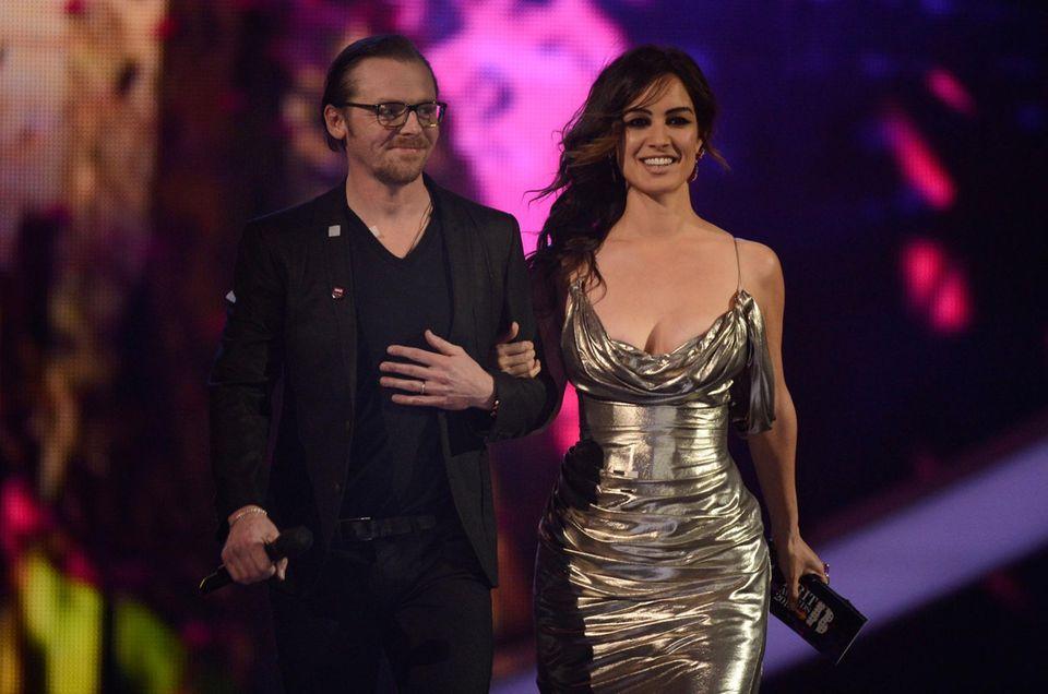 Die Schauspieler Simon Pegg und Bérénice Marlohe