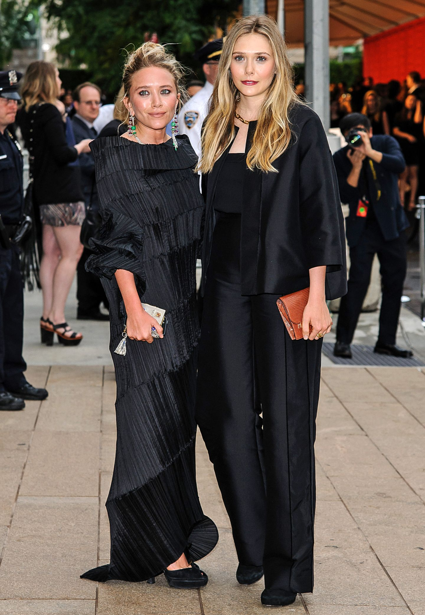 Mary-Kate Olsen in Issey Miyake, Elizabeth Olsen in The Row