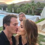 George Clooney funkt Rande Gerber und Cindy Crawford beim Küssen dazwischen.