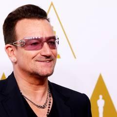 Bono kommt zum Luncheon, auch U2 sind für einen Oscar nominiert.