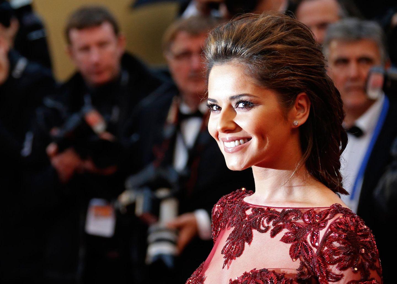 """Cheryl Cole schenkt den Fotografen bei der Premiere von """"Jimmy P."""" ein strahlendes Lächeln."""