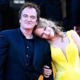 """Der Regisseur und seine Muse: Bei der Premiere zu """"Sils Maria"""" lehnt Uma Thurman sich an Quentin Tarantinos Schulter an."""