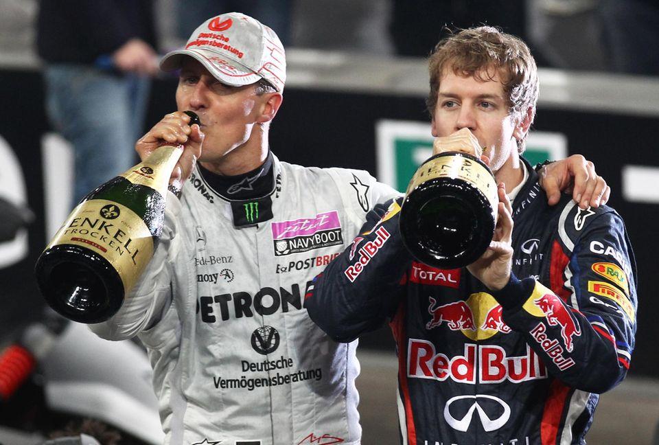 """Dezember 2011  Gemeinsam mit Sebastian Vettel freut sich Schumacher über den Sieg beim """"Nations Cup of the Race of Champions"""" in der """"Esprit Arena"""" in Düsseldorf."""
