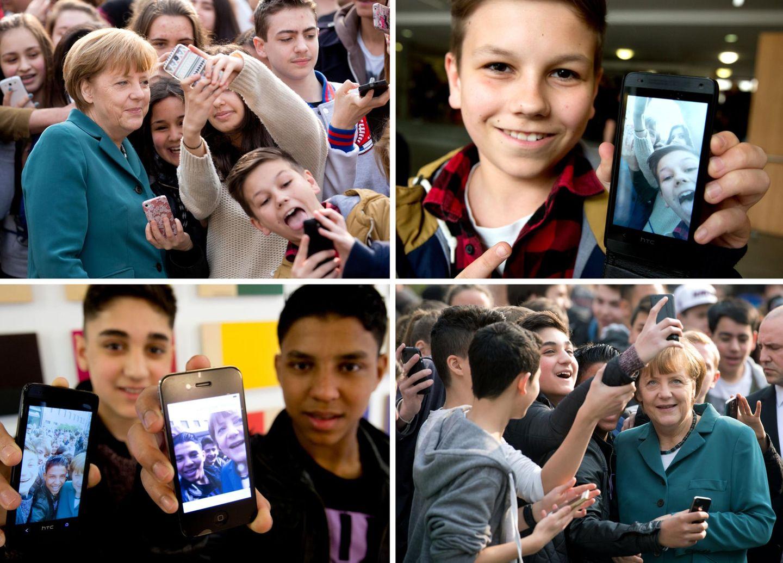 31. März 2014: Ein Selfie mit der Bundeskanzlerin: Bei ihrem Besuch der Staatlichen Europaschule Robert-Jungk in Wilmersdorf macht Angela Merkel geduldig Fotos mit den Schülern.