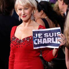 """Auch Helen Mirren bezieht sich mit ihrem Schild """"Je suis Charlie"""" auf das Attentat in Paris, bei dem zwölf Menschen starben."""