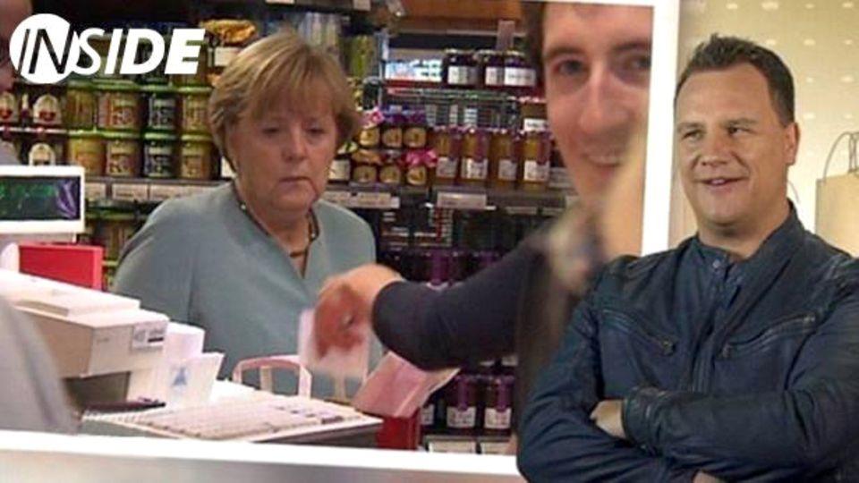 """Auch nach Jahren bei """"Shopping Queen"""" erlebt Kretschmer noch eine Überraschung. Die Kamera erfasst zufällig Kanzlerin Angela Merkel an einer Kaufhaus-Kasse."""