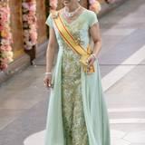 Die japanische Prinzessin Takamado strahlt in einer lindgrünen, brokatbesetzen Robe.