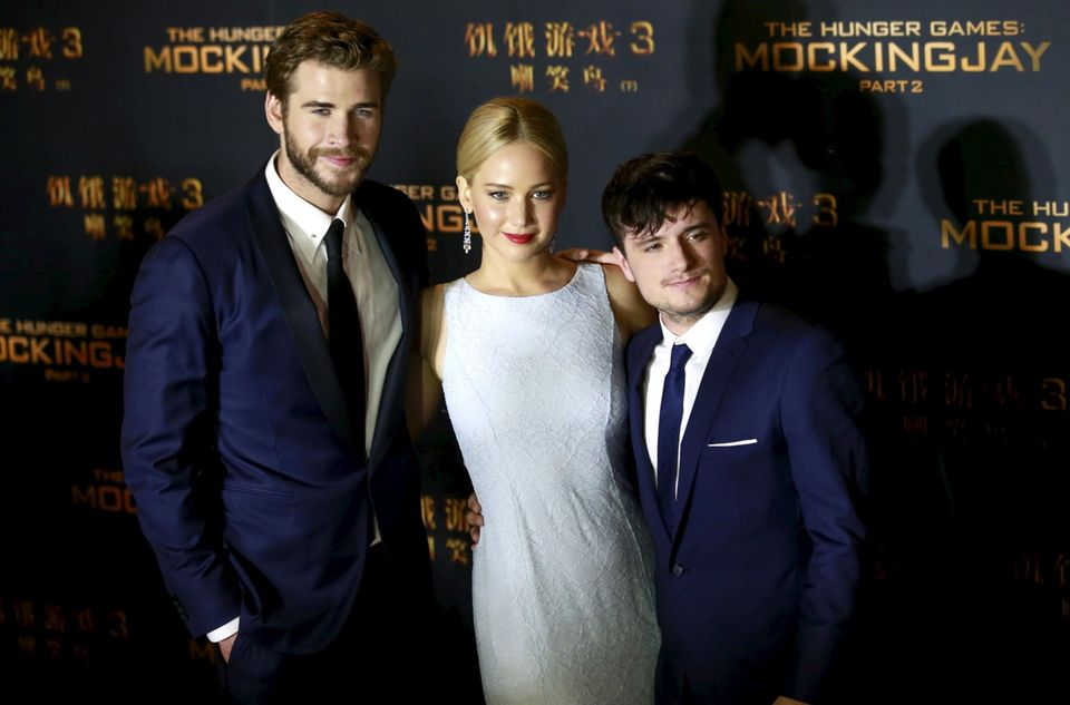 """Liam Hemsworth, Jennifer Lawrence und Josh Hutcherson stellen """"Mockingjay"""" in Peking vor."""