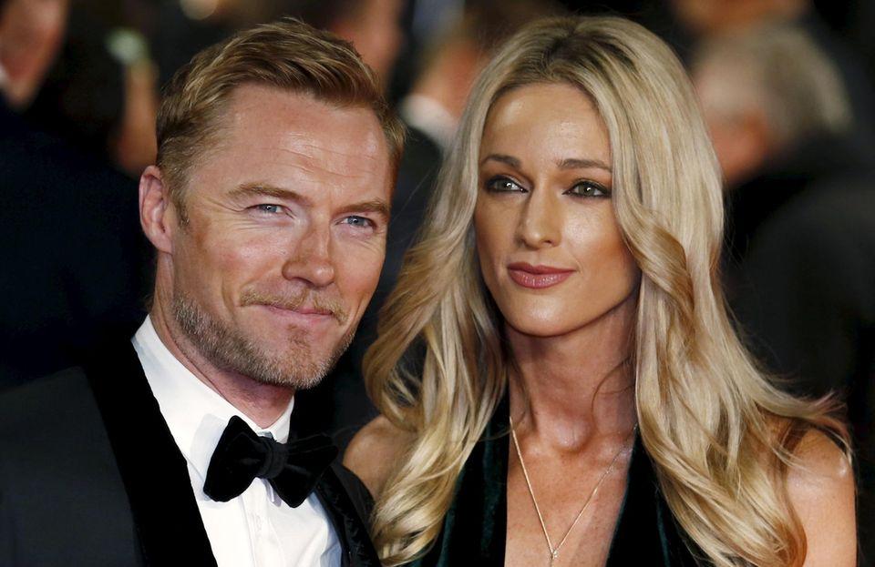 Ronan Keating besucht die Weltpremiere mit seiner Ehefrau Storm Uechtritz.