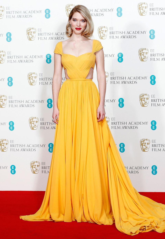 Wie die Sonne strahlt Léa Seydoux dei den BAFTAs in diesem Traumkleid von Prada.