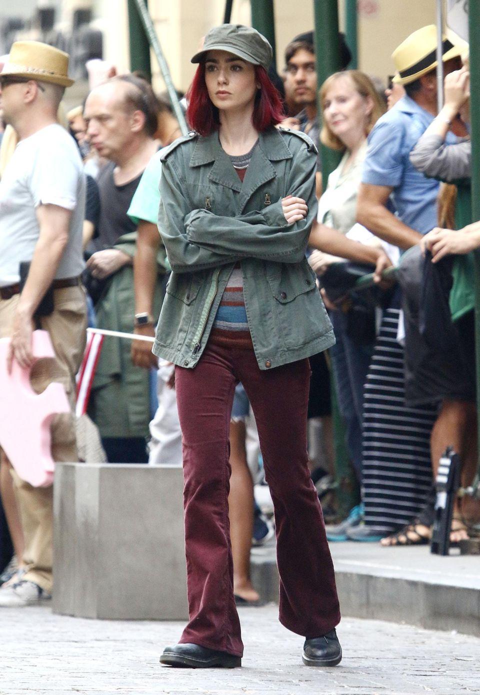 """23. Juli 2016: Lily Collins spielt in """"Okja"""" die Rolle """"Red"""". Das erklärt dann auch ihre neue Haarfarbe."""