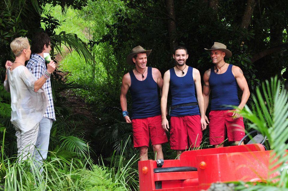 Jürgen Milski, Menderes Bagci und Thorsten Legat treten gemeinsam zur Dschungelprüfung an.